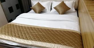 Hotel Swapna International - מומבאי - חדר שינה