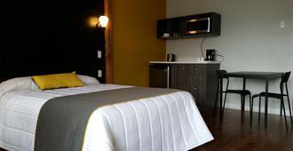 Motel Le Riviera - La Malbaie - Makuuhuone