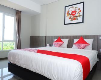 OYO 875 Love In Hotel & Resort - Jepara - Slaapkamer