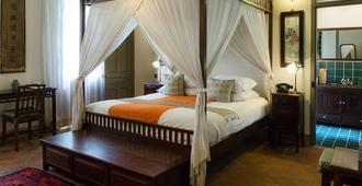 Satri House - לואנג פראבאנג - חדר שינה