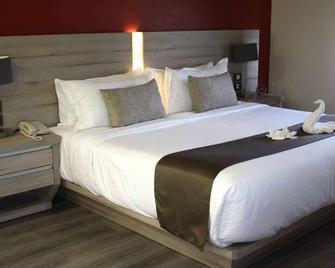 Domun Hotel - Куеретаро - Bedroom