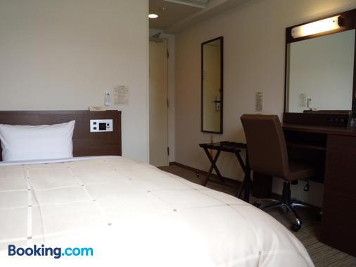 Hotel Route-Inn Tsuruoka Ekimae - Tsuruoka - Bedroom