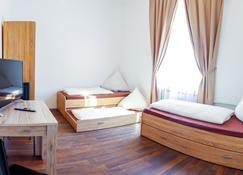 إف إم إم هوستل - ميمينغين - غرفة نوم