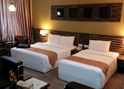HIG Hotel - Kuah - Bedroom
