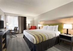 Country Inn & Suites by Radisson Flagstaff, AZ - Flagstaff - Bedroom