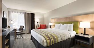 Country Inn & Suites by Radisson Flagstaff, AZ - Flagstaff - Bedroom