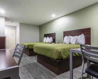 Scottish Inn And Suites - Tomball - Schlafzimmer