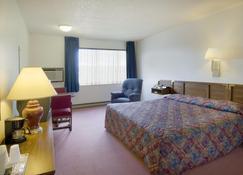 Americas Best Value Inn Laramie - Laramie - Bedroom