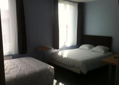 أوتيل مودرن - نانتير - غرفة نوم