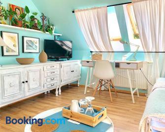 Pokoje Goscinne Magnolia Rooms - Serock - Wohnzimmer