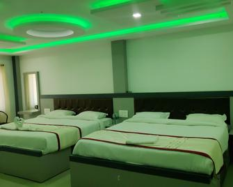 Hotel Shawrya The Grand - Madikeri - Slaapkamer