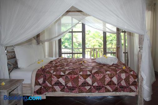 Papaya Guesthouse - North Kuta - Bedroom