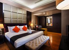 Hotel Ciputra Semarang Managed By Swiss-Belhotel International - Semarang - Bedroom