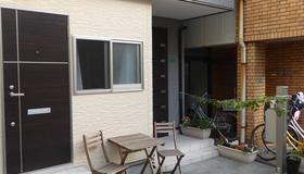 Auberge du Tanuki Noir - Hostel - Осака - Патио