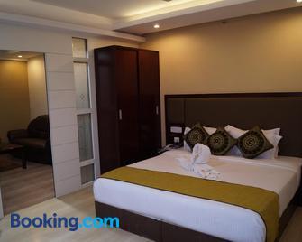 Hotel Winsar Park - Visakhapatnam - Bedroom