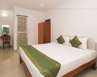 Treebo Trend Dom Pedros Haven - Utorda - Bedroom