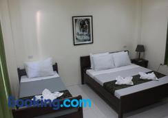 Blue Lagoon Inn & Suites - Puerto Princesa - Bedroom