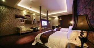 Dubai Villa Motel - טאיצ'ונג - חדר שינה