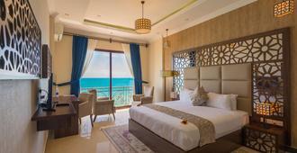 Golden Tulip Zanzibar Resort - סטון טאון - חדר שינה