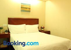Greentree Inn Taizhou Taixin Wenchang Road Business Hotel - Taixing - Bedroom