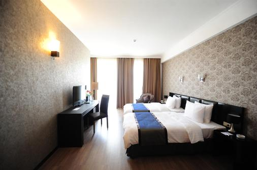 Best Western Tbilisi Art Hotel - Tbilisi - Phòng ngủ