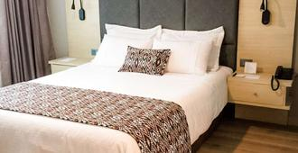 Novelty Suites Hotel - Medellín - Bedroom