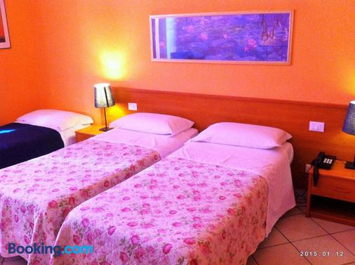 Hotel Leopolda - Florence - Phòng ngủ