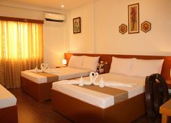 Casa Belina Tourist Inn - Puerto Princesa - Bedroom