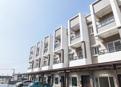 Beyond Home - Jiaoxi - Building