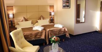 Grand Hotel Empire Frankfurt - פרנקפורט אם מיין - חדר שינה