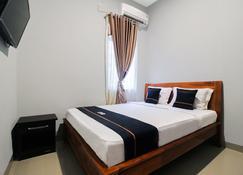 OYO 2659 B'rasco Homestay Syariah - Duri - Bedroom