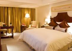 Days Hotel & Suites by Wyndham Fudu Changzhou - Changzhou - Phòng ngủ