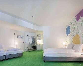 Flowers Hotels - Münster - Schlafzimmer