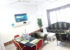 Feel Well Guest House - Parakou - Sala de estar