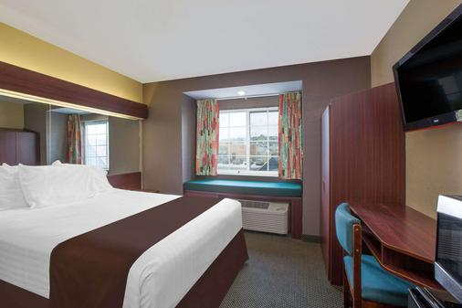 Microtel Inn & Suites by Wyndham Meridian - Meridian - Schlafzimmer