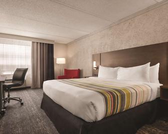 Country Inn & Suites by Radisson, Mt Pleasant - Sturtevant - Ložnice