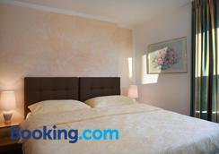 海爾維蒂亞公寓式酒店 - 克萊恩 蒙塔納 - 臥室