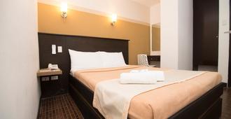 We Travelers Inn - Puerto Princesa - Bedroom