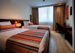 Best Western PLUS Santa Marta Hotel - Santa Marta - Schlafzimmer