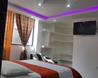 Hostal La Cascada - Baños (Tungurahua) - Bedroom