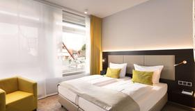 Top Cityline Hotel Platzhirsch Fulda - Fulda - Camera da letto