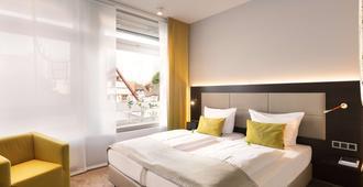 Top Cityline Hotel Platzhirsch Fulda - פולדה - חדר שינה