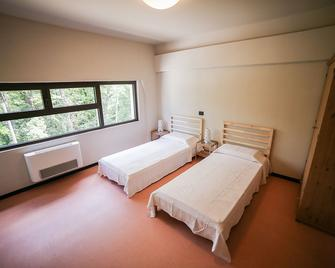 Oasi Hostel - Merone - Bedroom