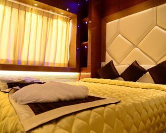Tri Sea Hotel - Kanniyākumāri - Bedroom
