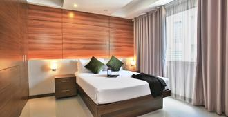 Valero Grand Suites By Swiss-Belhotel Makati - Makati - Camera da letto