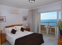 Apartamentos Jardins da Rocha - Портімау - Спальня