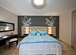 Ciqala Luxury Suites - San Juan - Chambre