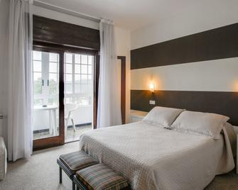 San Luis - Vilaboa - Schlafzimmer