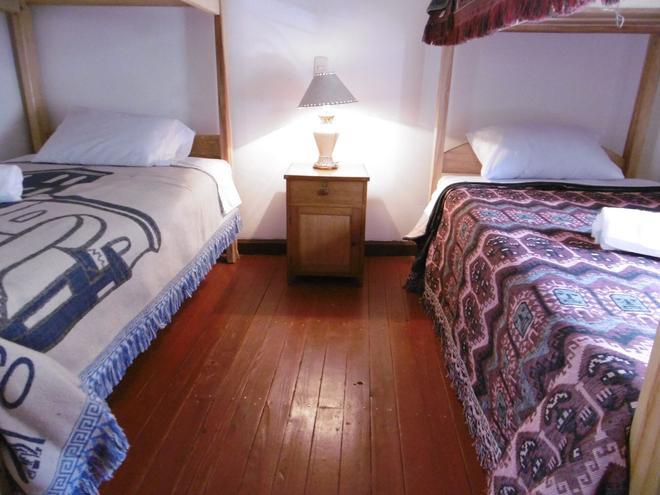 America Guest House - Cuzco - Habitación