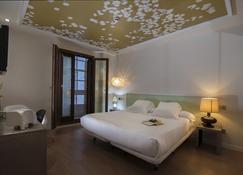 卡薩斯雷亞爾精品酒店 - 聖地亞哥-德孔波斯特拉 - 臥室